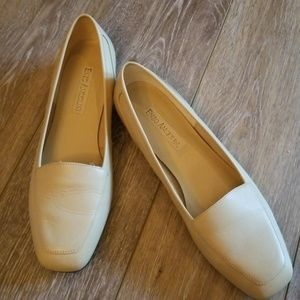 Barely broke in cream leather loafers.